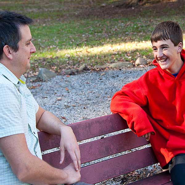 Man Talking To A Boy